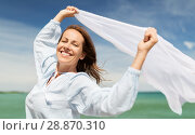 Купить «happy woman with shawl waving in wind on beach», фото № 28870310, снято 15 июня 2018 г. (c) Syda Productions / Фотобанк Лори