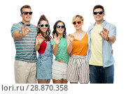 friends in sunglasses showing ok hand sign. Стоковое фото, фотограф Syda Productions / Фотобанк Лори