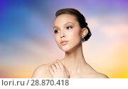 Купить «close up of beautiful woman face with earring», фото № 28870418, снято 9 апреля 2016 г. (c) Syda Productions / Фотобанк Лори