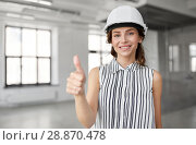 Купить «architect in helmet showing thumbs up at office», фото № 28870478, снято 8 июня 2018 г. (c) Syda Productions / Фотобанк Лори