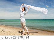 Купить «happy woman with shawl waving in wind on beach», фото № 28870494, снято 15 июня 2018 г. (c) Syda Productions / Фотобанк Лори
