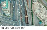 Купить «Aerial top view of road junction in Moscow from above, automobile traffic and jam of many cars, transportation concept», видеоролик № 28870654, снято 30 июля 2018 г. (c) Mikhail Starodubov / Фотобанк Лори