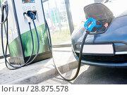 Купить «electric car charging. Ecological automobile», фото № 28875578, снято 6 июля 2018 г. (c) Дмитрий Калиновский / Фотобанк Лори