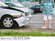 Купить «car accident on street. damaged automobiles after crash in city», фото № 28875594, снято 14 июля 2018 г. (c) Дмитрий Калиновский / Фотобанк Лори