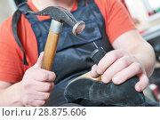 Купить «Shoemaker repair female spike shoe. Hammering tip on heel», фото № 28875606, снято 25 апреля 2018 г. (c) Дмитрий Калиновский / Фотобанк Лори