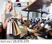 Купить «Girl looking after summer pair of shoes», фото № 28876370, снято 21 сентября 2018 г. (c) Яков Филимонов / Фотобанк Лори
