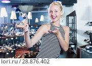 Купить «Girl customer showing sandals in fashion boutique», фото № 28876402, снято 20 сентября 2018 г. (c) Яков Филимонов / Фотобанк Лори