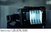 Купить «vr headset with virtual cube hologram», видеоролик № 28876590, снято 19 сентября 2018 г. (c) Syda Productions / Фотобанк Лори