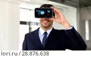 Купить «businessman with vr headset and cube on screen», видеоролик № 28876638, снято 19 сентября 2018 г. (c) Syda Productions / Фотобанк Лори