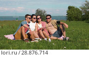 Купить «friends taking picture by selfie stick in summer», видеоролик № 28876714, снято 19 июля 2018 г. (c) Syda Productions / Фотобанк Лори