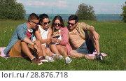 Купить «friends taking picture by selfie stick in summer», видеоролик № 28876718, снято 19 июля 2018 г. (c) Syda Productions / Фотобанк Лори