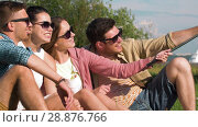 Купить «friends taking picture by selfie stick at seaside», видеоролик № 28876766, снято 19 июля 2018 г. (c) Syda Productions / Фотобанк Лори
