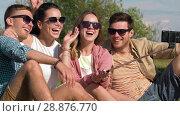 Купить «friends taking picture by selfie stick at seaside», видеоролик № 28876770, снято 19 июля 2018 г. (c) Syda Productions / Фотобанк Лори