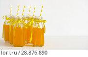 Купить «juice or lemonade in glass bottles with straws», видеоролик № 28876890, снято 13 июля 2018 г. (c) Syda Productions / Фотобанк Лори
