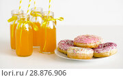 donuts and lemonade or juice in glass bottles. Стоковое видео, видеограф Syda Productions / Фотобанк Лори