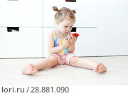 Купить «Cute 2 years toddler girl with mobile phone at home», фото № 28881090, снято 23 июля 2018 г. (c) ivolodina / Фотобанк Лори