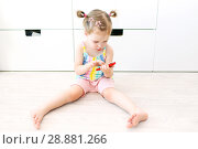 Купить «2 years toddler girl with mobile phone at home», фото № 28881266, снято 23 июля 2018 г. (c) ivolodina / Фотобанк Лори