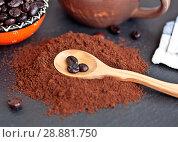 Купить «Wooden spoon with coffee beans lies on the hill of ground coffee», фото № 28881750, снято 3 августа 2018 г. (c) Элина Гаревская / Фотобанк Лори
