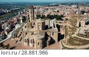 Купить «View from drone of Catalan city of Lleida with medieval Cathedral of St. Mary of La Seu Vella», видеоролик № 28881986, снято 25 июля 2018 г. (c) Яков Филимонов / Фотобанк Лори