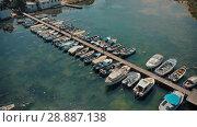 Купить «Docked boats at summer day», видеоролик № 28887138, снято 20 июля 2018 г. (c) Илья Шаматура / Фотобанк Лори