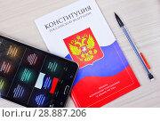 Купить «Конституция РФ и мобильное устройство с приложением важнейших нормативных актов», фото № 28887206, снято 1 июля 2018 г. (c) Oles Kolodyazhnyy / Фотобанк Лори
