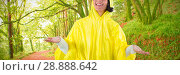 Купить «Composite image of woman in yellow raincoat gesturing to feel the rain», фото № 28888642, снято 24 октября 2018 г. (c) Wavebreak Media / Фотобанк Лори