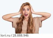 Купить «astonished pretty girl holds her head in hands», фото № 28888946, снято 6 июня 2018 г. (c) Александр Лычагин / Фотобанк Лори