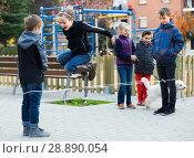 Купить «children playing rubber band», фото № 28890054, снято 15 октября 2019 г. (c) Яков Филимонов / Фотобанк Лори