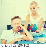 Купить «Sister is asking forgiveness from her offendedly brother and offering to play ball», фото № 28890102, снято 7 августа 2017 г. (c) Яков Филимонов / Фотобанк Лори
