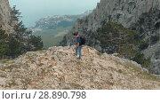 Купить «Man hiking and taking picture of nature», видеоролик № 28890798, снято 19 июля 2018 г. (c) Илья Шаматура / Фотобанк Лори