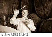 Купить «man with glass of wine in winery cellar», фото № 28891942, снято 22 сентября 2016 г. (c) Яков Филимонов / Фотобанк Лори