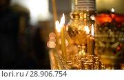 Купить «Believers in the church. Russian Orthodox Church», видеоролик № 28906754, снято 7 августа 2018 г. (c) Mikhail Erguine / Фотобанк Лори
