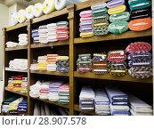 Купить «different fabric bolts exposed on shelves», фото № 28907578, снято 2 марта 2018 г. (c) Яков Филимонов / Фотобанк Лори