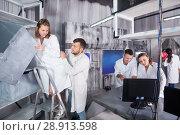 Купить «Adults trying to get out of escape room», фото № 28913598, снято 6 июля 2017 г. (c) Яков Филимонов / Фотобанк Лори