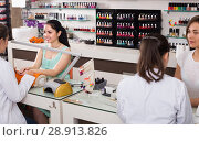 Купить «Manicurists giving manicure to female clients at nail salon», фото № 28913826, снято 28 апреля 2017 г. (c) Яков Филимонов / Фотобанк Лори