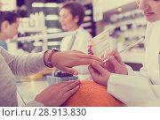 Купить «Manicurists giving manicure», фото № 28913830, снято 28 апреля 2017 г. (c) Яков Филимонов / Фотобанк Лори