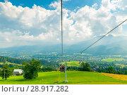 Купить «cable car with ski lifts, beautiful scenery and view of the Tatra Mountains, Poland», фото № 28917282, снято 17 августа 2017 г. (c) Константин Лабунский / Фотобанк Лори