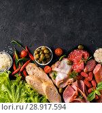 Купить «Cold smoked meat plaatter antipasti», фото № 28917594, снято 7 августа 2018 г. (c) Ольга Сергеева / Фотобанк Лори