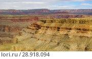 Купить «aerial view of grand canyon cliffs from helicopter», видеоролик № 28918094, снято 21 июля 2018 г. (c) Syda Productions / Фотобанк Лори