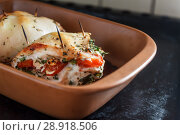 Купить «Baked poultry fillet stuffed with soft cheese, tomatoes and herbs in a ceramic baking dish. The concept of the proper beneficial health food, diet», фото № 28918506, снято 15 апреля 2018 г. (c) Tetiana Chugunova / Фотобанк Лори