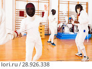 Купить «woman fencer practicing fencing combination», фото № 28926338, снято 11 июля 2018 г. (c) Яков Филимонов / Фотобанк Лори
