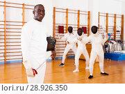 Купить «African american man fencer in training room», фото № 28926350, снято 11 июля 2018 г. (c) Яков Филимонов / Фотобанк Лори