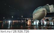 Купить «Passenger airplane of Korean Air with boarding bridge, night view», видеоролик № 28926726, снято 4 октября 2017 г. (c) Данил Руденко / Фотобанк Лори