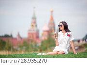 Купить «Happy young urban woman drinking coffee in european city.», фото № 28935270, снято 26 июля 2018 г. (c) Дмитрий Травников / Фотобанк Лори