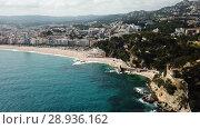 Купить «View from drone of Castell d'en Plaja in Mediterranean coastal town of Lloret de Mar, Catalonia, Spain», видеоролик № 28936162, снято 11 июня 2018 г. (c) Яков Филимонов / Фотобанк Лори