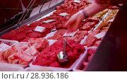 Meat production displayed for sale in butcher's shop. Стоковое видео, видеограф Яков Филимонов / Фотобанк Лори