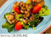 Купить «Baked champignons marinated in soy sauce with balsamic, served with vegetables», фото № 28936442, снято 18 октября 2018 г. (c) Яков Филимонов / Фотобанк Лори