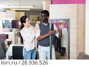 Adult woman with her husband are looking on modern cupboard for their house. Стоковое фото, фотограф Яков Филимонов / Фотобанк Лори