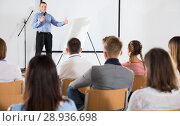 Купить «Male professor delivering speech to students», фото № 28936698, снято 25 июля 2018 г. (c) Яков Филимонов / Фотобанк Лори