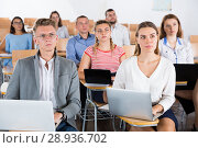 Купить «Group of people with laptops in lecture hall», фото № 28936702, снято 25 июля 2018 г. (c) Яков Филимонов / Фотобанк Лори